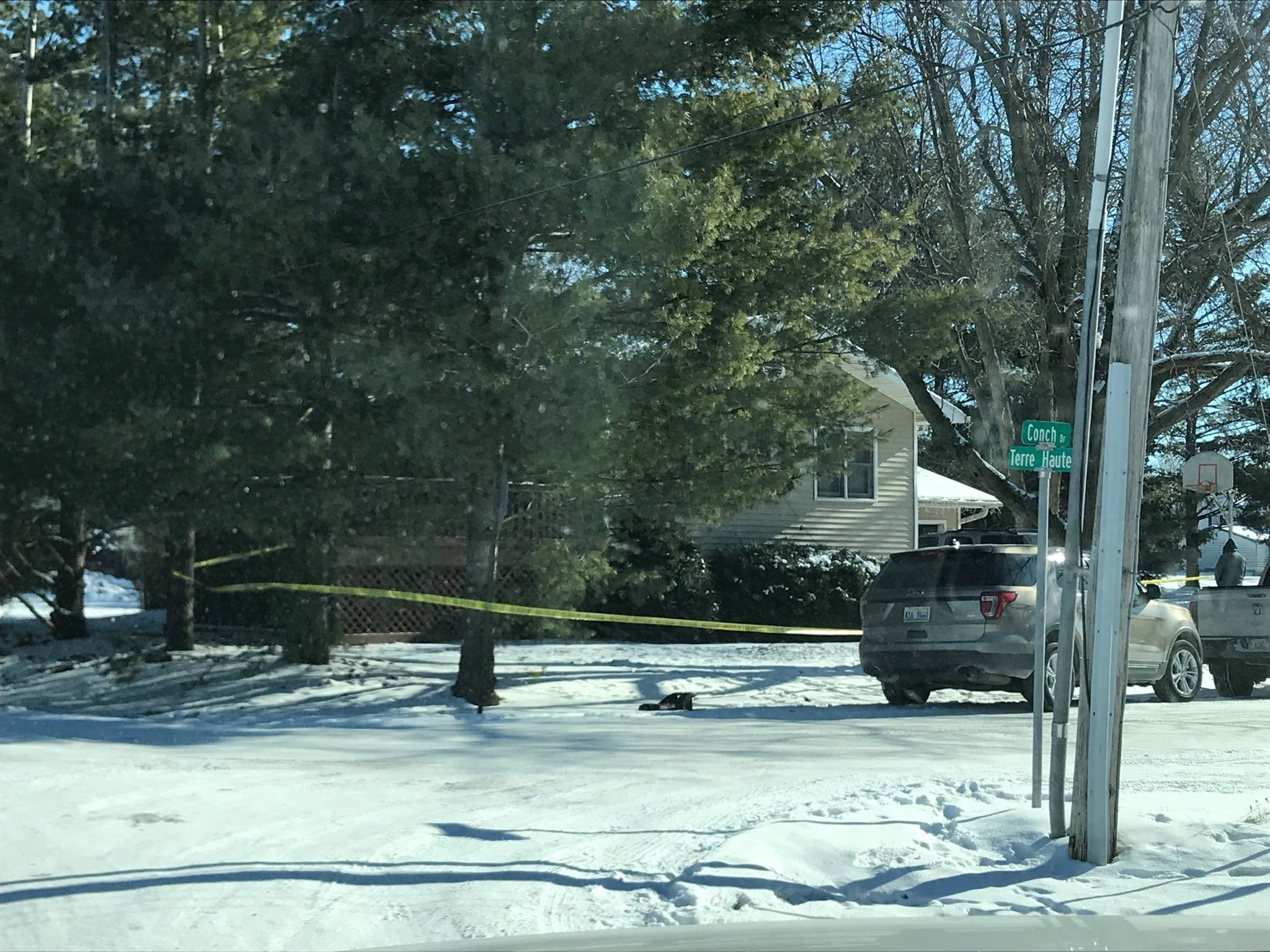 Crime scene tape surrounds a home in La Harpe, Illinois Monday morning as police investigate a shooting.
