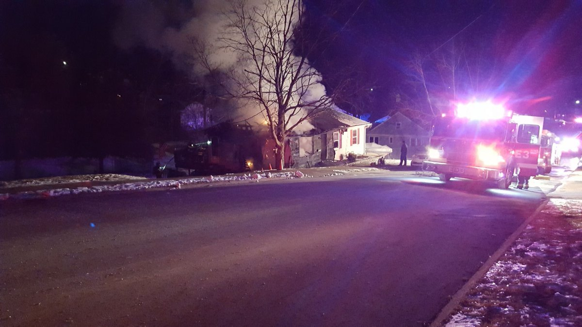 Smoke billows from a home at 608 North Hawkins Street in Hannibal Monday night.