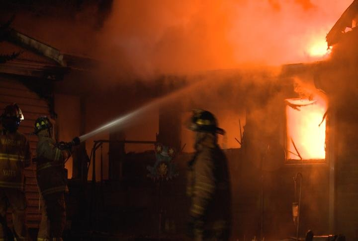 Flames engulf a Warsaw, Illinois home.