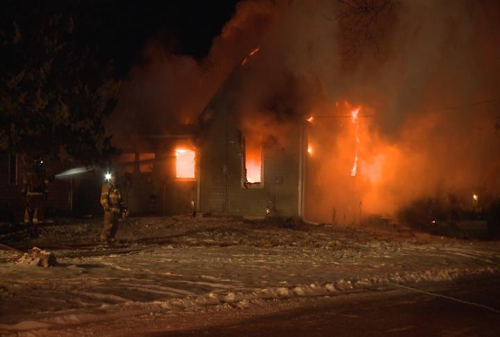 Firefighters say they arrived to a fully involved fire on Mulberry Street in Warsaw, Illinois