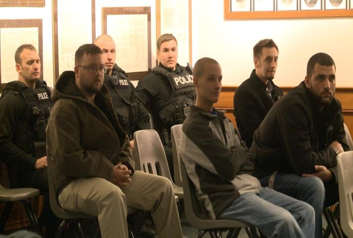 Several interested applicants and current Quincy Police Officers listen to a discussion.