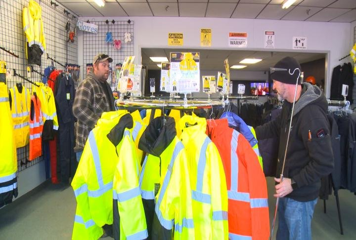 Local workers trying on coats at the store.