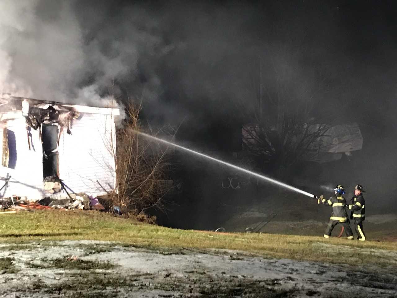 Fire crews battling a house fire in Hannibal