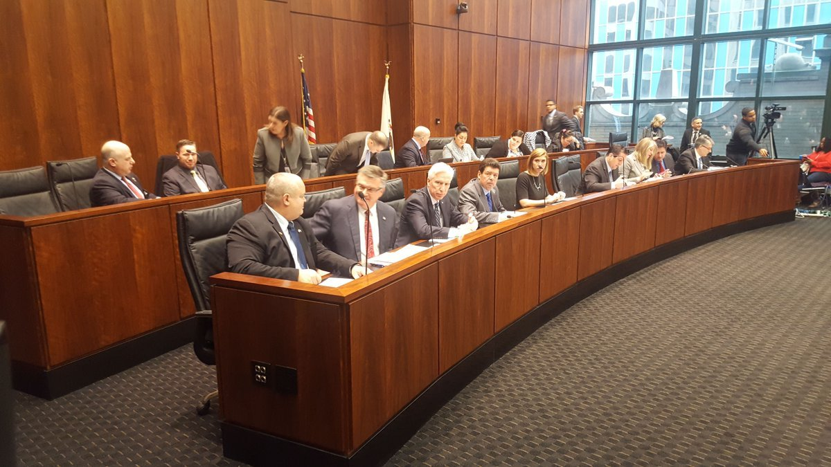 The legislative committee before the start of the hearing.