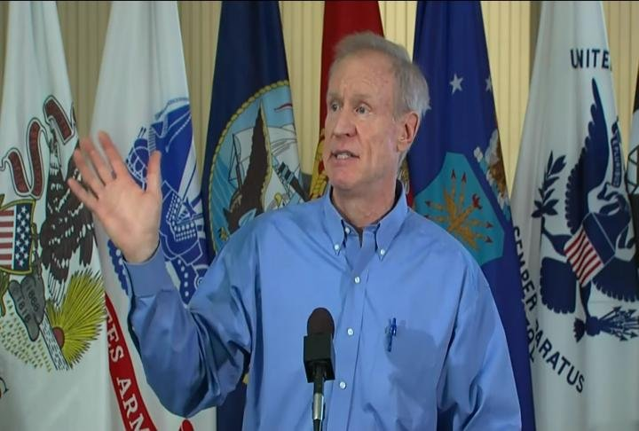 Rauner talking to the media in the vets home.