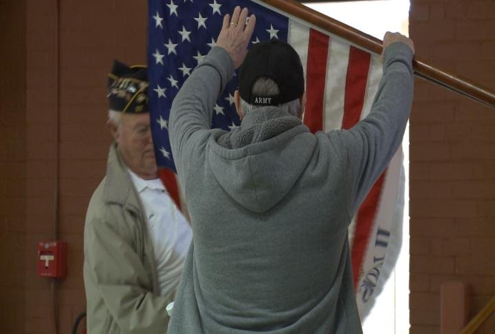 Vets taking down the flag.