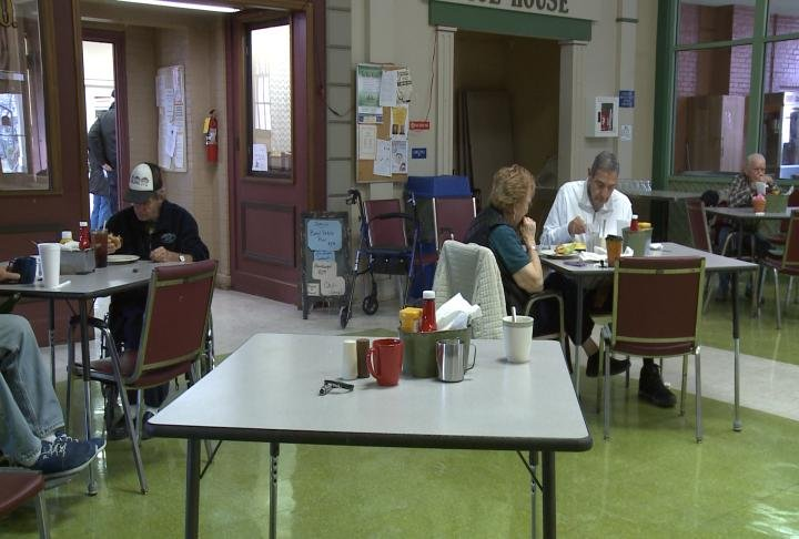 Vets eating in the lunch room.