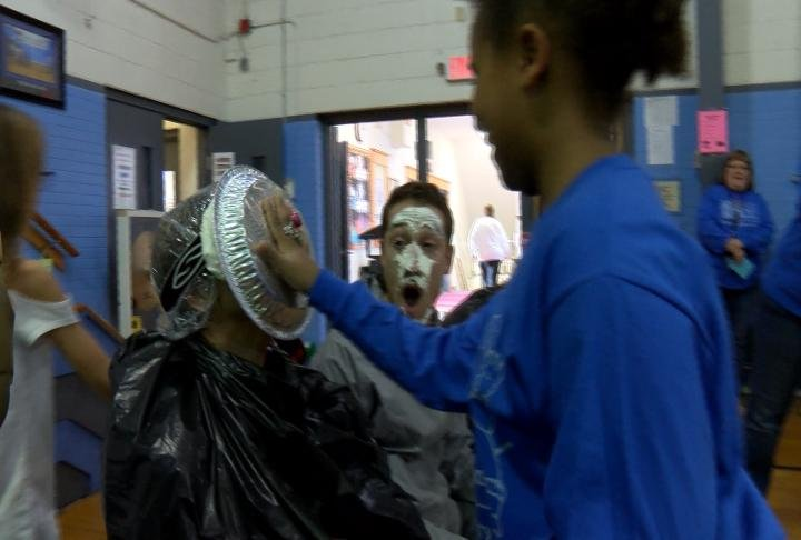 Student pies a teacher in the face to celebrate the news.