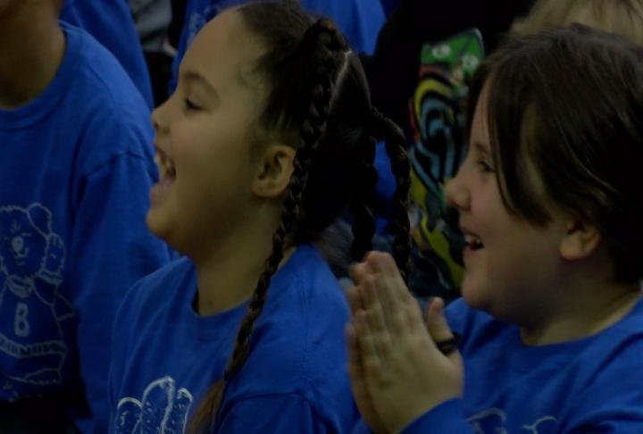 Students laugh during the celebration of the Lighthouse school announcement.