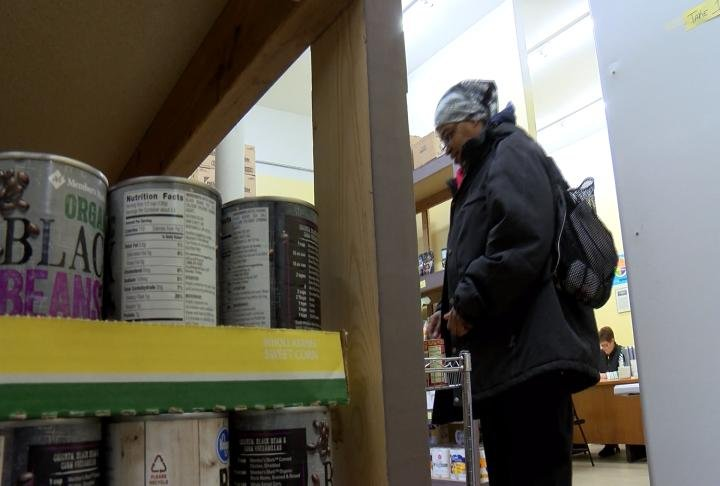 Yvette Wilson picking out items at Horizons food pantry.