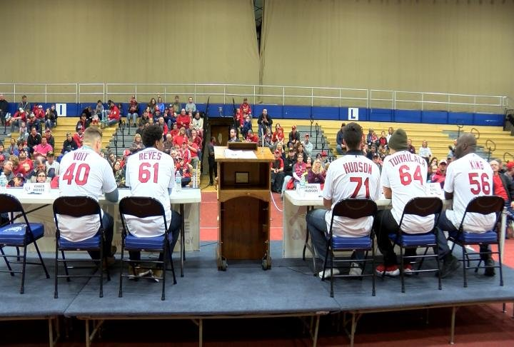 The annual Cards Caravan featuring four current players and one former player made a stop at Quincy's Blue Devil Gym on Monday.