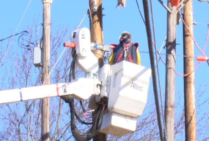 Workers upgrading power lines.