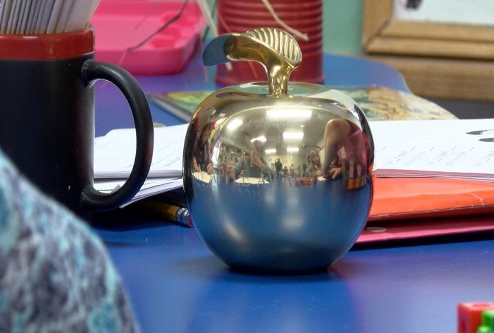 Golden Apple sitting on desk