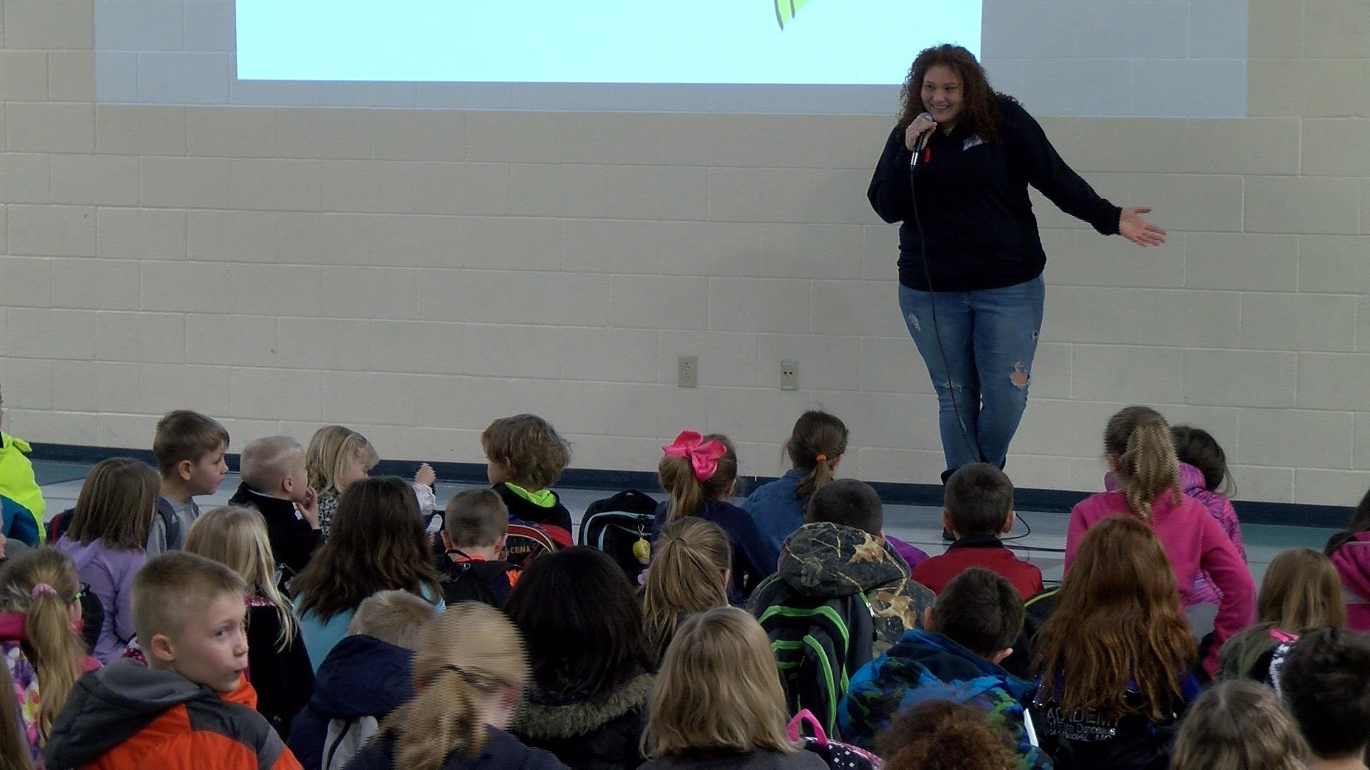 "Teens in Motion participant Ariana Clark leads Thursday's ""Be A Buddy"" launch presentation at Mark Twain Elementary School."