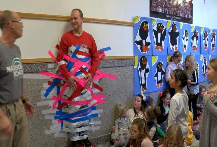 A math frequency challenge allowed students to tape their principal to the wall.