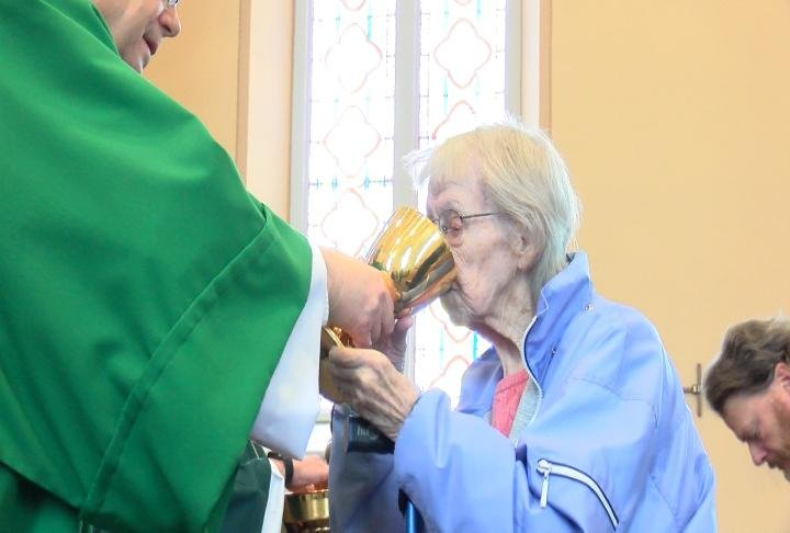 A parishioner taking from the common cup