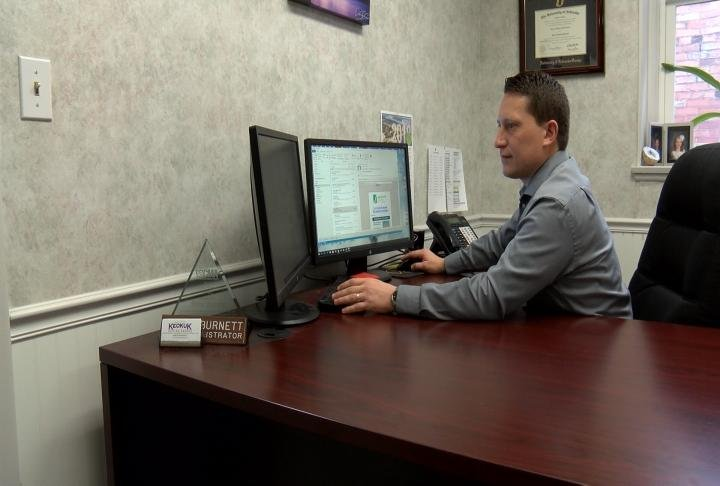 Aaron Burnett at his desk.