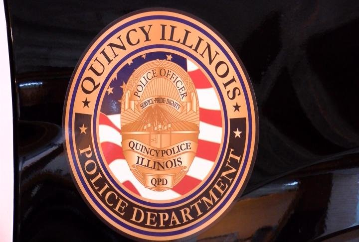 The logo of the Quincy Police Department.