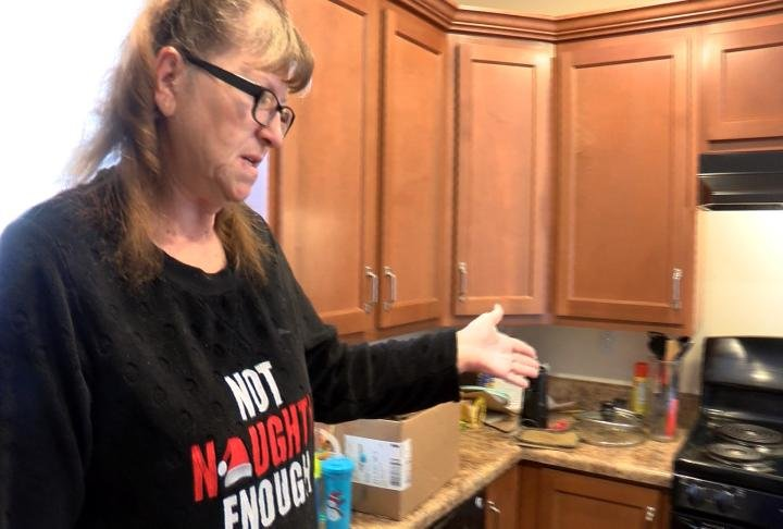 Jeanne Bigham showing off her kitchen