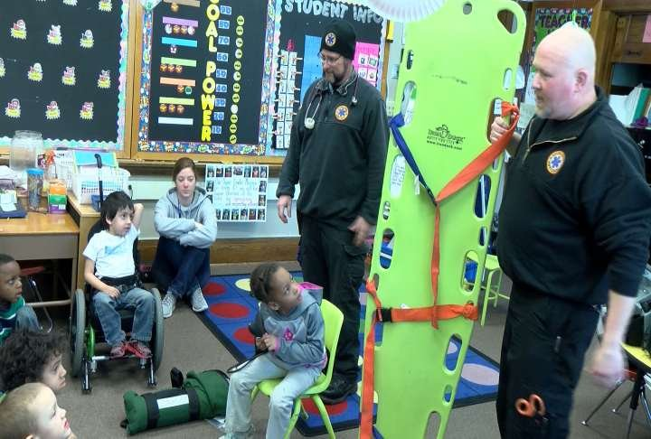 Parametics with the Adams County Ambulance Service show children at Washington Elementary School some of the equipment they use in the field.