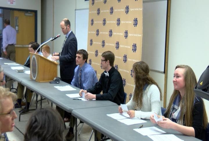 Seven of QND's senior student athletes signed on the dotted line Wednesday morning.