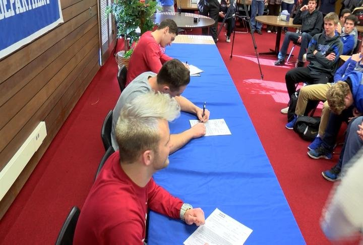 Quincy's Avery Wilson, Logan Ross, and Brock Baird signed their national letters of intent Wednesday.
