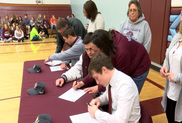 Unity's Todd Kelly, Dakota Ehrhardt, and Taylor Klusmeyer put pen to paper earlier this week to commit to the QU football program.