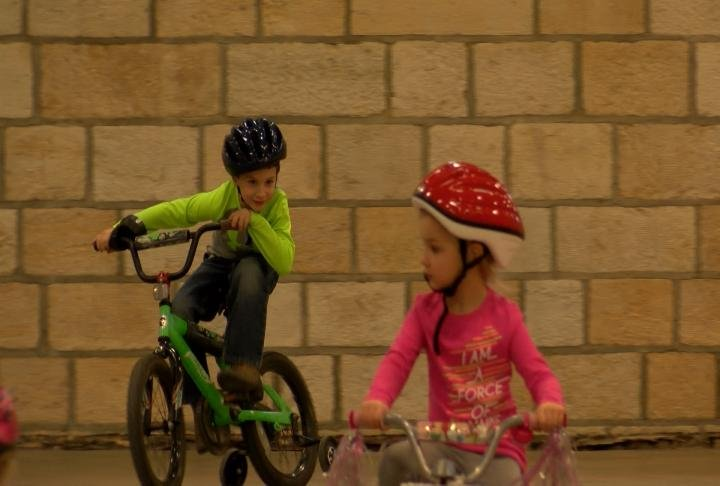 Kids got a chance to ride their bikes inside the recreation center.
