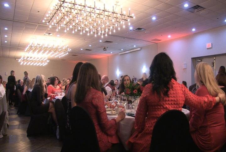 Many attendees wear red in honor of the event.
