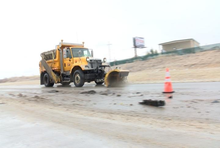A MoDOT snow plow on the highway