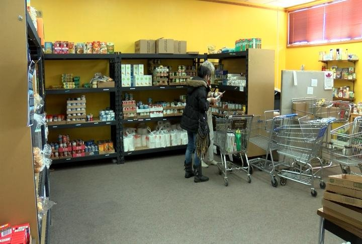 People being helped in the pantry.