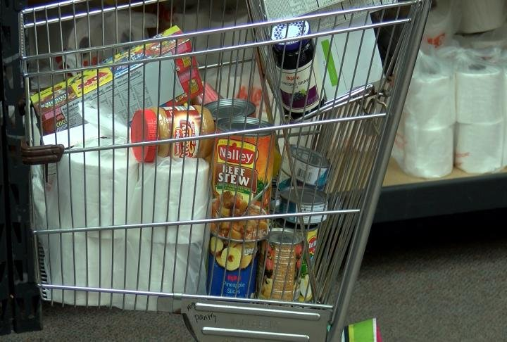 Cart filled with food and other toiletries.