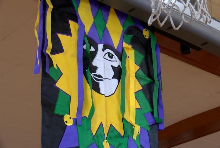 Mardi Gras theme under the basketball hoop.