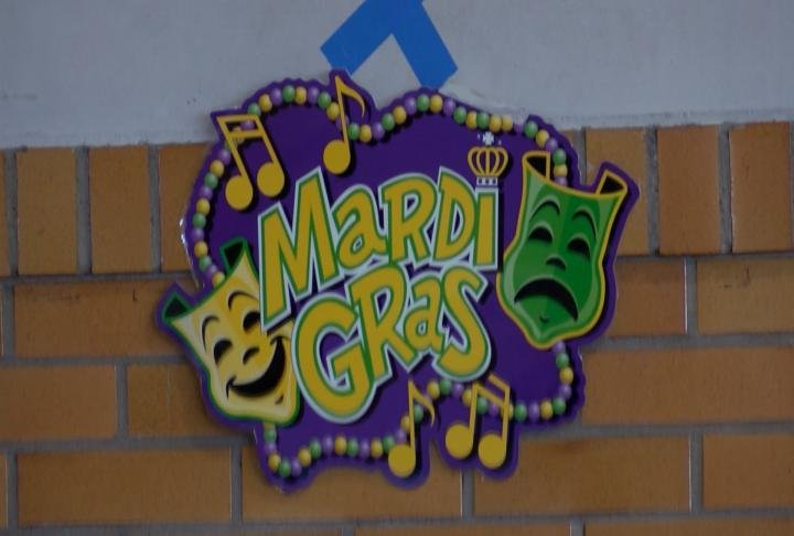 Mardi Gras signs placed around the school.