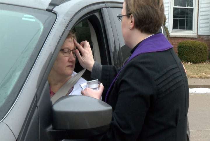 "Rev. Danyelle Trexler places a cross of ashes on a parishioner during Wednesday's ""Ashes To Go"" event."