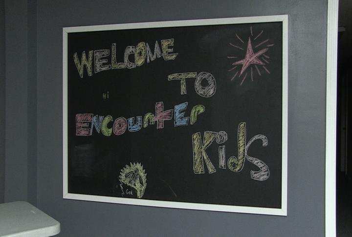 The chalkboard inside the kids church.