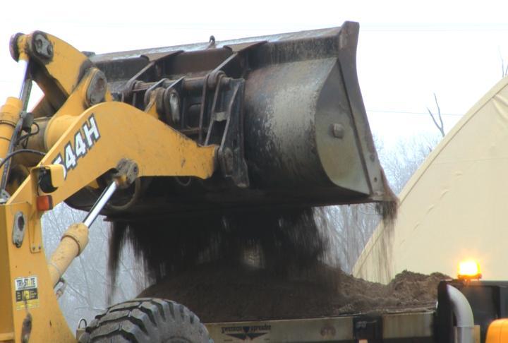 A MoDOT truck dumping salt.