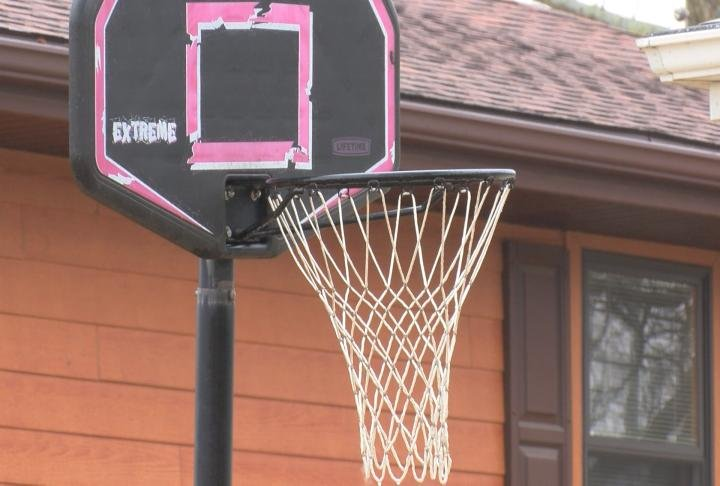 A portable basketball hoop in the driveway of a home in Palmyra.