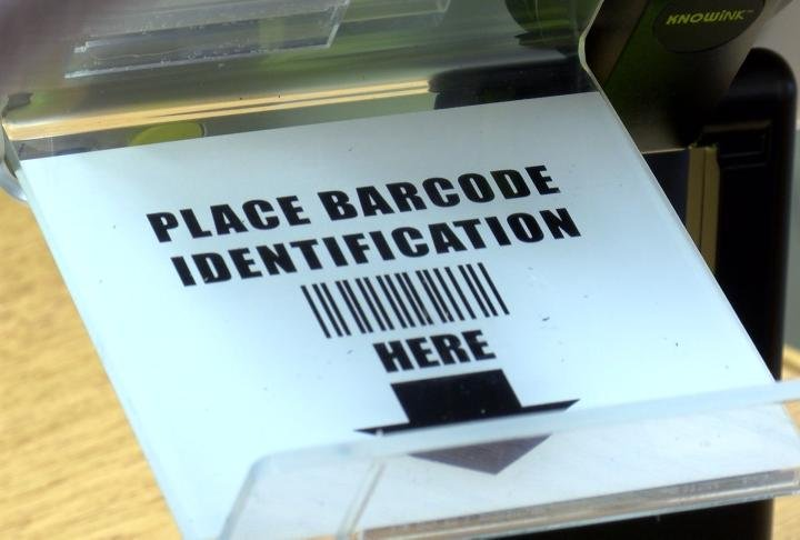 Voters will be able to scan their photo I.D. to sign in.