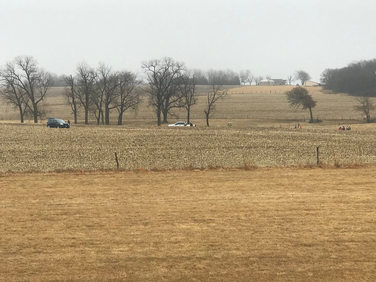 Crime tape being put up in the field, off Highway 24.