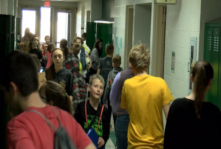 Students walking through the hallway at the middle school.