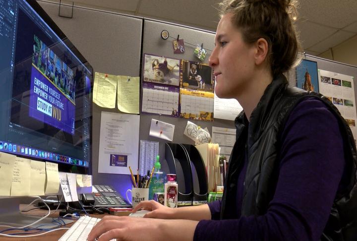 WIU grad student Amanda Pankhurst working on her computer