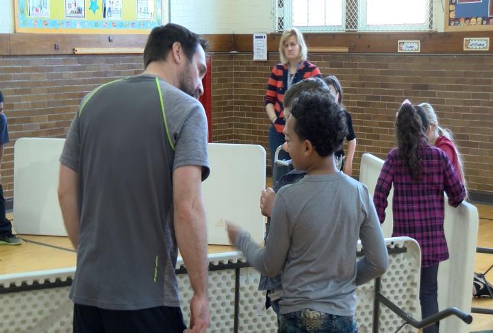 Broekemeier talking to student