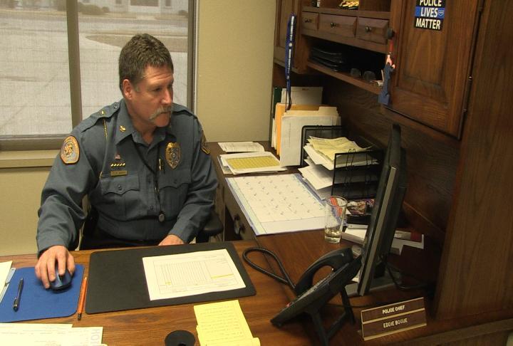 Palmyra Police Chief Eddie Bogue works at his desk.
