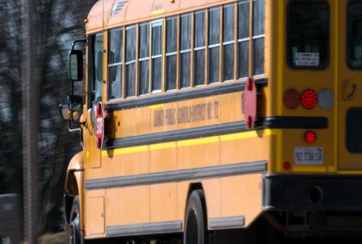A school bus on afternoon routes for Quincy Public Schools.