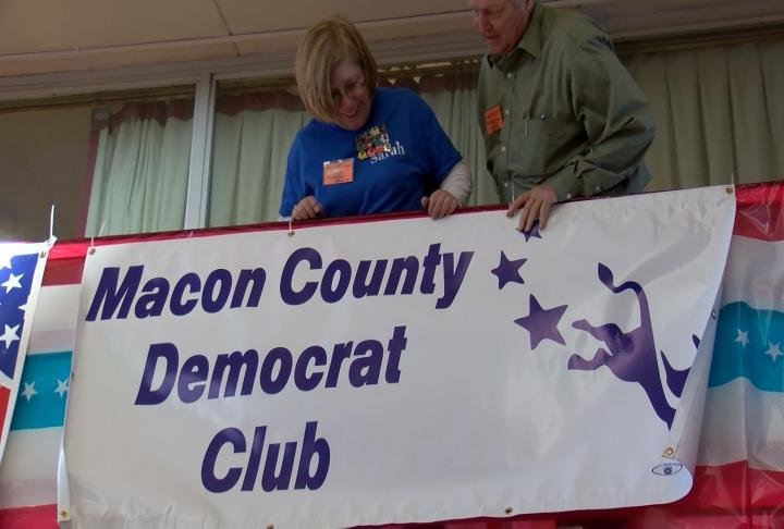 The Macon County Democrat Club is putting up a banner inside the Hannibal Inn.