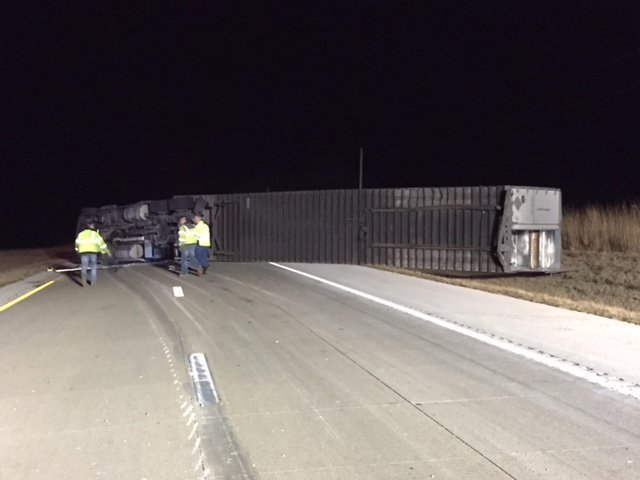 Tractor trailer flipped on its side.