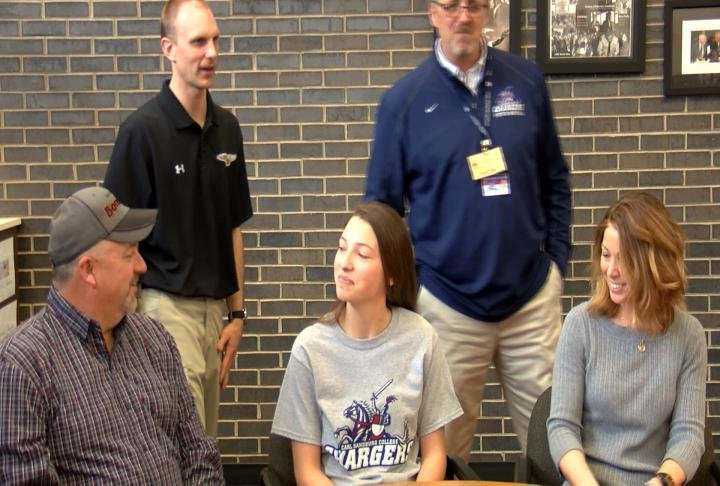 Macomb's Sophie Whitford signed on with Carl Sandburg women's basketball Wednesday.