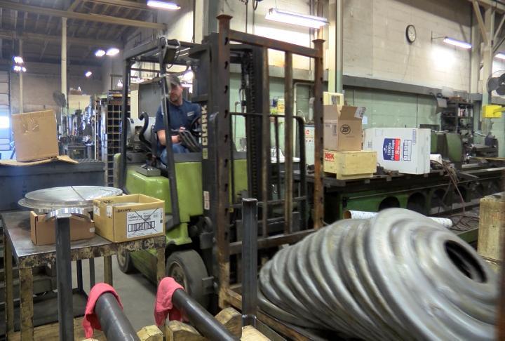 An employee at Awerkamp Machine Co.