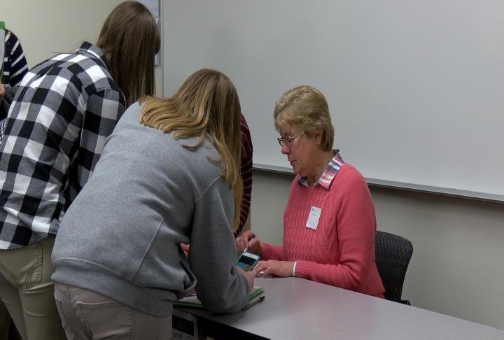 Volunteers helped assist students make decisions and balance their budgets.